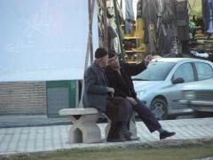 Yazd, men in Amir Chakmak square