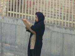 Yazd, student in Amir Chakmak square