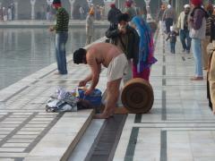 Amritsar, Golden Temple, people praying 2